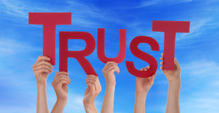 Many People Hands Holding Red Word Trust Blue Sky Stock Photo