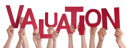 Many People Hands Holding Red Word Valuation. Many Caucasian People And Hands Holding Red Letters Or Characters Building The Isolated English Word Valuation On stock photos
