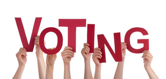 Many People Hands Holding Red Word Voting. Many Caucasian People And Hands Holding Red Letters Or Characters Building The Isolated English Word Voting On White stock image