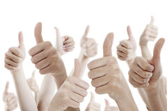 Many people holding their thumbs up stock photography