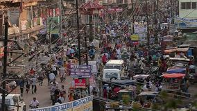 Many people indian at the street. Vendors, buyers and. The road, many wires stock footage
