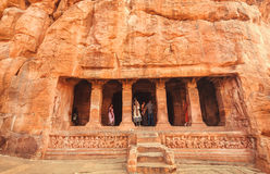 Many people inside ancient caves with the 6th century Hindu temple and carved columns Stock Images
