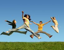 Many people jumping on grass, collage. Many people jumping on the green grass, collage Royalty Free Stock Images