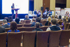 Many People at the Law Conference Listening to The Female Host Stock Images