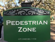 PEDESTRIAN ZONE - A SIGN IN SAVANNAH, GEORGIA WARNS PEOPLE AN AREA OF A PARK IS ONLY FOR WALKIN. Many people love to cycle these days, but also forget that other Stock Image