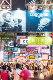 Many people in Mongkok street at night. Stock Photography