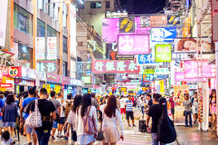 Many people in Mongkok street at night. Royalty Free Stock Photo