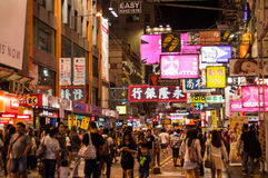 Many people in Mongkok street at night. Stock Photos
