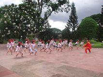 Many people participate in sports activities at beaches and parks - Quy Nhon, Vietnam in 2011. The event of a company with many people involved, they participate royalty free stock photo