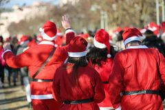 Many people with red dress of Santa Claus during a sport race. Many people with red dress of Santa Claus during a race called Running with Santa royalty free stock photos