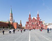 Many people on Red Square. Moscow - April 12, 2015: Many citizens and tourists walk and see the sights on Red Square in the early spring weather is nice, April Stock Photo