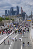 Many people ride bicycles in Moscow city center. Stock Image