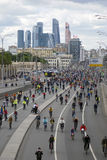 Many people ride bicycles in Moscow city center. Stock Photography