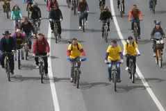 Many people ride bicycles in Moscow city center. Stock Photos