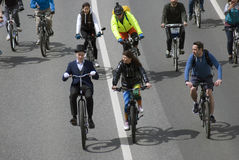 Many people ride bicycles in Moscow city center. Stock Images