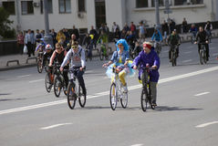 Many people ride bicycles in Moscow city center. Royalty Free Stock Photo