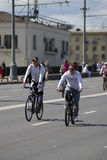 Many people ride bicycles in Moscow city center. Stock Photo