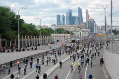 Many people ride bicycles in Moscow city center. Royalty Free Stock Images