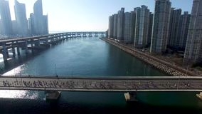 Many People are running on the bridge, Centum City, Haeundae, Busan, South Korea, Asia.  stock footage