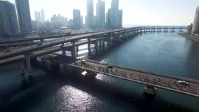Many People are running on the bridge, Centum City, Haeundae, Busan, South Korea, Asia.  stock video footage