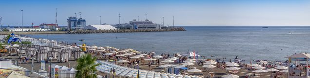 SOCHI, RUSSIA-AUGUST 13, 2018: Riviera Beach on the background of the sea station. royalty free stock image