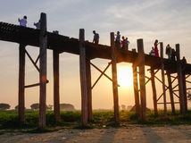 Many people see the sunset on the bridge in Mandalay, Myanmar Stock Image