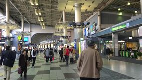 Many people at Shinjuku train station in Tokyo, Japan.  stock video footage