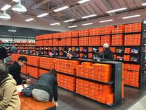 Many people shopping shoes in the karuizawa outlet. Karuizawa Japan - November 19, 2016 : Many people shopping shoes in the karuizawa outlet near Karuizawa royalty free stock images