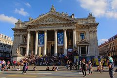 Many people sitting in front of Brussels` stock exchange building Royalty Free Stock Photography