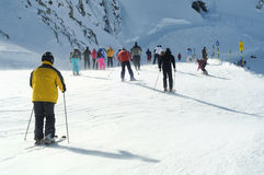 Many People skiing in european alps. Stock Photo