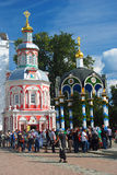 Many people stand in a queue in Trinity Sergius Lavra. Stock Photos