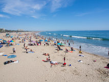 Many people sunbathe in Santa Monica Beach. LOS ANGELES, USA - MAY 4: Many people sunbathe on the sand beach and swim in the ocean on May 4, 2014 in Santa Monica Royalty Free Stock Images