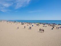 Many people sunbathe in Santa Monica Beach. LOS ANGELES, USA - MAY 4: Many people sunbathe on the sand beach and swim in the ocean on May 4, 2014 in Santa Monica Stock Photos