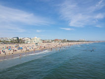 Many people sunbathe in Santa Monica Beach. LOS ANGELES, USA - MAY 4: Many people sunbathe on the sand beach and swim in the ocean on May 4, 2014 in Santa Monica Stock Images
