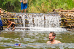 Many people swimming at the small weir irrigate Stock Photo