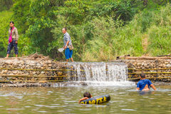Many people swimming at the small weir irrigate Royalty Free Stock Images