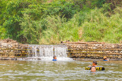 Many people swimming at the small weir irrigate Royalty Free Stock Photo