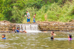 Many people swimming at the small weir irrigate Stock Photography