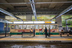 Many people using `Centram` tram in the Toyama station Royalty Free Stock Images
