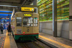 Many people using Centram tram in the Toyama station at night. Royalty Free Stock Image