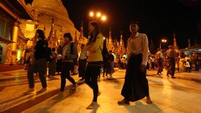 Many people visit at Shwedagon Pagoda stock video footage