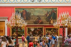 Many people visit the State Hermitage Museum. SAINT PETERSBURG, RUSSIA - AUGUST 18, 2017: Many people visit the State Hermitage Museum in Saint Petersburg royalty free stock photo