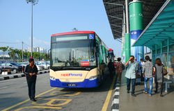 Many people wait for the bus at the station in Penang Airpor Royalty Free Stock Photo