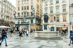 Many people walking at central part of austrian capital with old and modern buildings Royalty Free Stock Photos