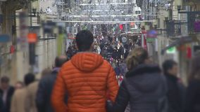 Many people walking down beautifully decorated street, enjoying shopping, slowmo. Stock footage stock video footage
