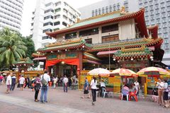 Many people walking in front of Kwan Im Thong Hood Cho Temple stock photos