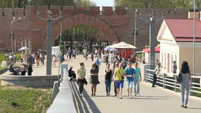 Many people walking on a pedestrian bridge stock video footage
