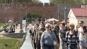 Many people walking on a pedestrian bridge stock video