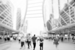 Many people walking on the skywalk with blurry image royalty free stock image