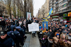 Many people walking to the anti-government demonstration past the police forces during  the pro-European protest in Kyiv Stock Photos